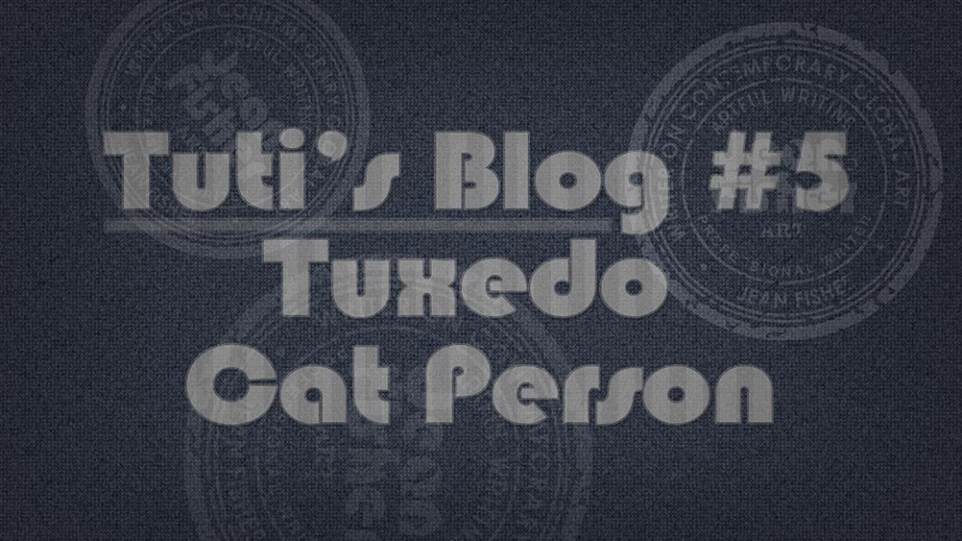 Tuxedo cat person text on a fabric background