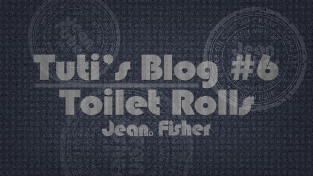 Toilet rolls text on a fabric background