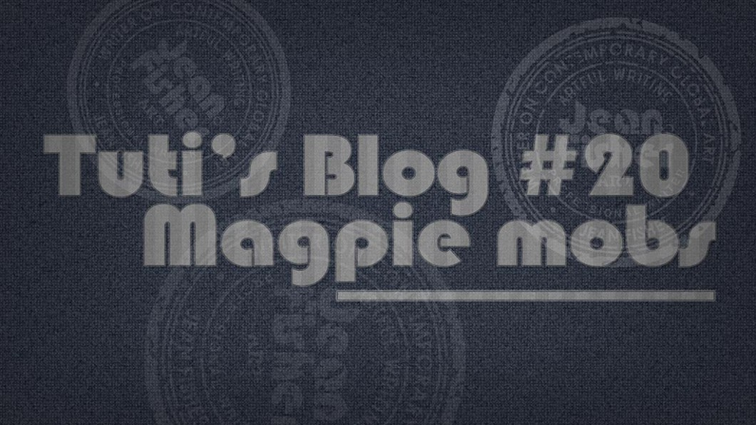 Magpie mobs text on a fabric background